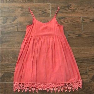 Coral dress with crochet hem at the bottom